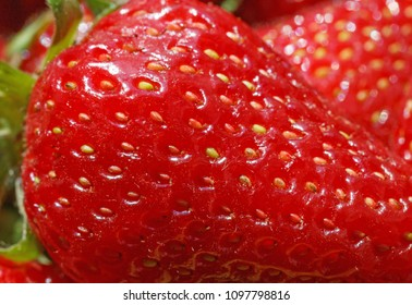extreme close up of red strawberry
