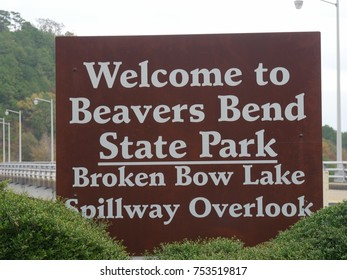 Extreme close up shot of the sign at the Beavers Bend state park spillway overlook at the Broken Bow lake