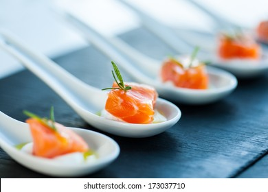 Extreme close up of smoked salmon morsel catering.