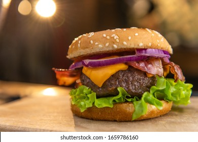 Extreme close up of a tasty, delicious, freshly made hamburger on a pub or restaurant table