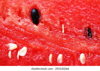 Extreme close view of a slice of watermelon.