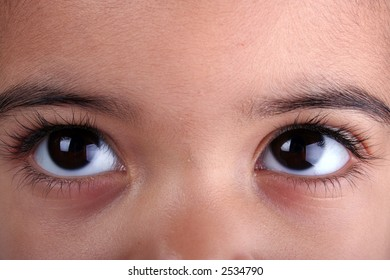Extreme close up of a young toddle girls brown eyes