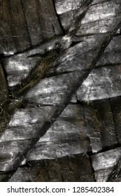 Extreme closeup (5x) of gray woven fiber placemat.