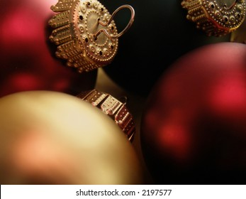 Extreme closeup of Christmas ornaments detailing the ornamental hooks.