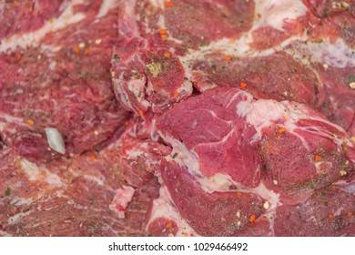 extreme closeup detail of spicy boneless meat ready for grilling, shallow focus