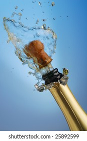 Extreme close-up of explosion of champagne bottle cork