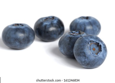 Extreme close-up image of blueberries on white background