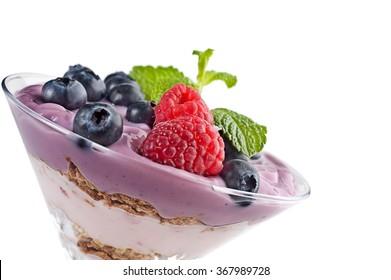 Extreme close-up image of fruit yogurt and cereal on white background