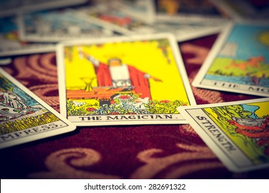 Extreme close-up macro shot of The Magician tarot card with shallow depth of field.