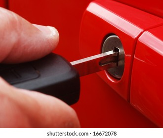 Extreme close-up of male inserting key into car