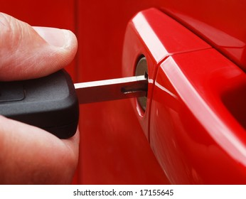 Extreme closeup of man inserting key into car lock