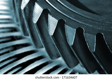Extreme closeup of an old gear from a car gear box.(Shallow DOF)