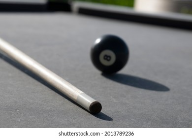 Extreme Close-up of pool cue and 8 ball