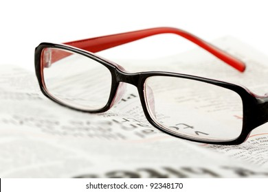 Extreme Closeup Reading glasses with newspaper
