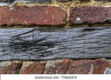 Extreme close-up from red bricks with wood timber background