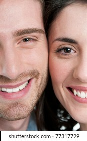 Extreme closeup of smiling young couple faces