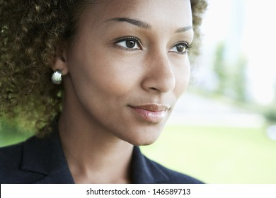 Extreme closeup of a young businesswoman looking away outdoors