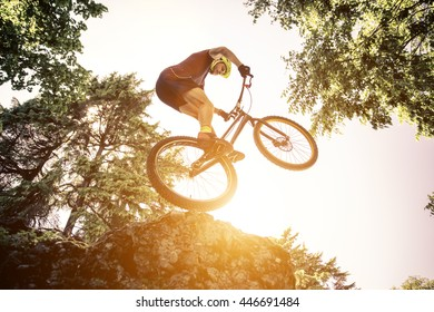 Extreme jump with a trial bicycle. concept about downhill and mountain bike