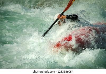 Extreme kayaker in slalom race.