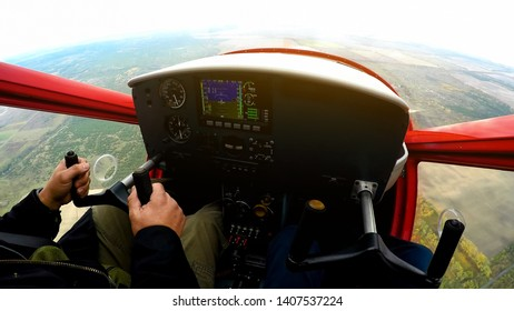 Extreme lesson on sports plane, POV of man looking at control panel, adrenaline