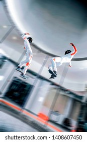Extreme. Levitation in sports wind tunnel. Indoor sky diving. Team flyers. Yoga fly in wind tunnel. Indoor skydiving.