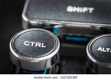 An extreme macro shot with shallow depth of field and selective focus on the key word CTRL in a black and silver vintage-inspired clicky typewriter keyboard.
