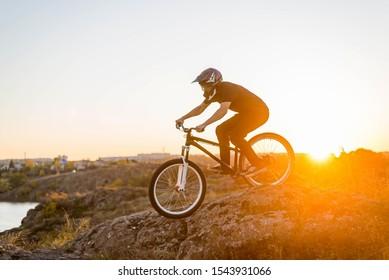 Extreme mountain biking at beautiful sunset, downhill. MTB.