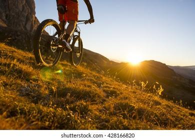 Extreme mountainbike sport athlete riding outdoors trail