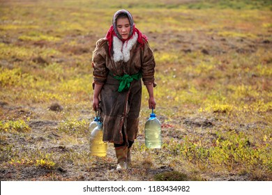 The extreme north, Yamal, the past of Nenets people, the dwelling of the peoples of the north, Women of Nenets nationality stay near their yurts and sled. Nomad Nenets people live in yurts.