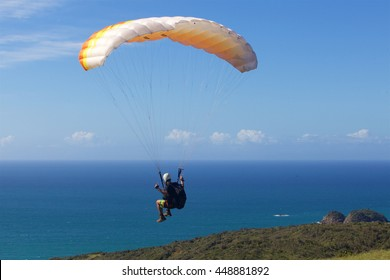 extreme paraglider over the beach