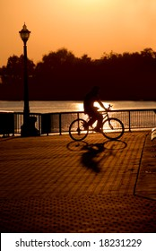 Extreme silhouette of casual cyclist in public park, Weber Point, Stockton California