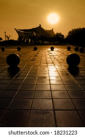 Extreme silhouette of public park and wet pavement at Weber Point in Stockton California