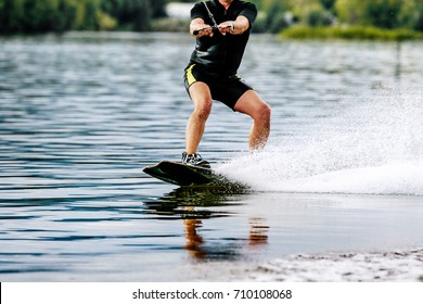 extreme sports man rides a wakeboard on lake