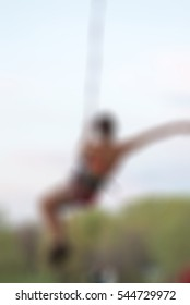 Extreme sports ropejumping theme creative abstract blur background with bokeh effect