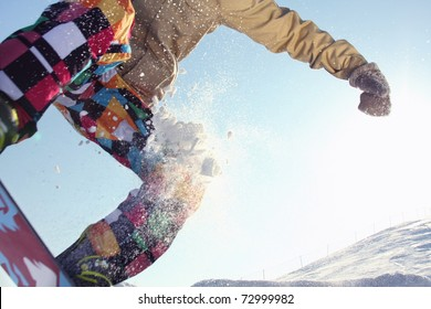 Extreme sports: snowboarder flying in air, closeup