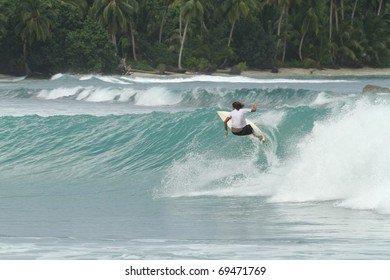Extreme sports surfer in paradise