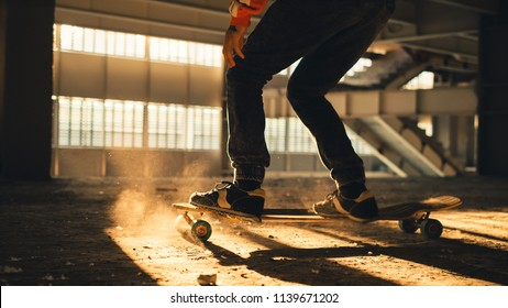 Extreme street sport. Closeup of legs and sneakers on skateboard