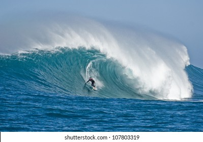 Extreme surfers riding some giant waves