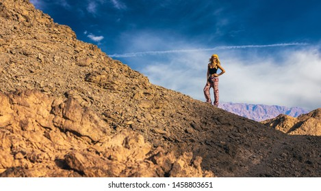 extreme traveling concept wallpaper pattern photography for some touristic agency with smiling photogenic sexy travel girl in dramatic desert scenery landscape, copy space