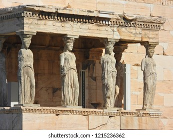 Extreme zoom closeup detail photo of iconic Caryatids statues in porch of Caryatids located on top of Acropolis hill next to iconic masterpiece Parthenon, Athens historic center, Attica, Greece