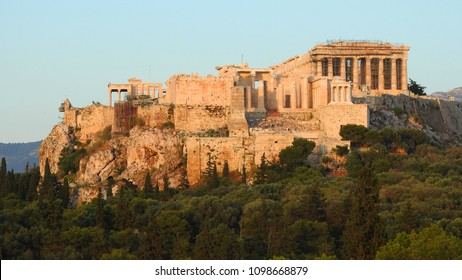 Extreme zoom photo of iconic Parthenon and Propylaia in Acropolis hill as seen from Pnyka, Athens historic center, Attica, Greece