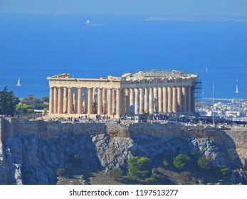 Extreme zoom photo revealing great detail of iconic Acropolis hill and the Pathenon as seen from Lycabettus hill on a sunny morning, Athens historic center, Attica, Greece