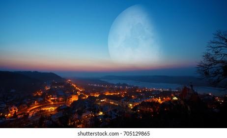 Extremely big moon over the city, Kazimierz Dolny by Vistula River, Poland