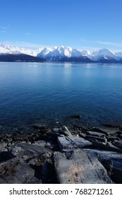 Extremely Blue Alaska Bay on the way to Seward  overlooking the glazier with the clear blue sky