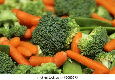 extremely close up fresh salad including broccoli and carrot