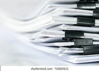 extremely close up  stacking of office working document with paper clip folder