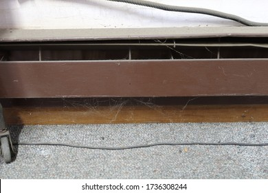 Extremely dirty electric baseboard heater in need of maintenance