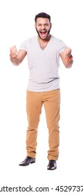 """Extremely excited latino man with the fists up against. Screams loudly while makes the """"yes"""" gesture. Full length portrait. Isolated on white background."""