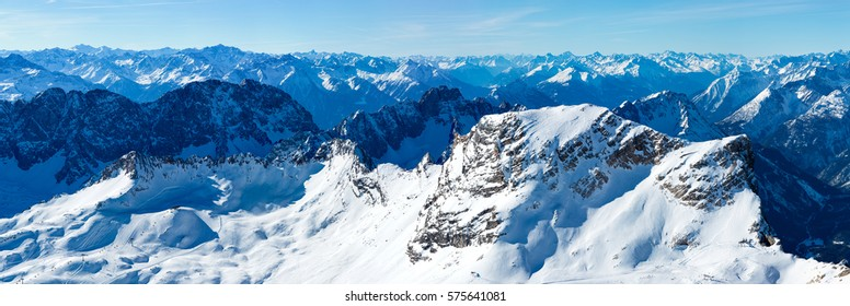 Extremely highly detailed panorama shot of the Zugspitz glacier area and surrounding mountains on a winter morning with spectacular view.