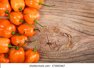 Extremely Hot Habanero Peppers on wooden background